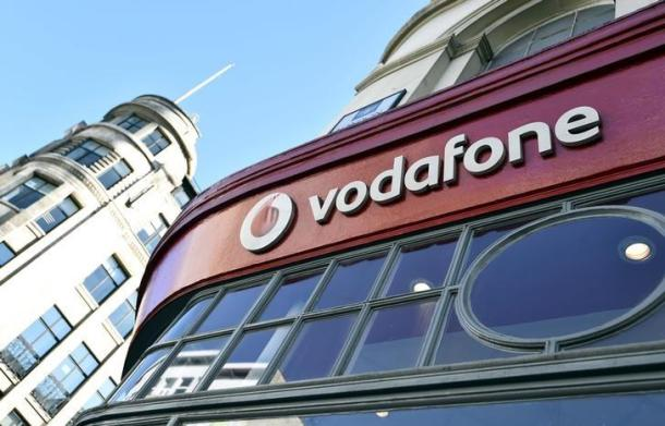 Branding for Vodafone is seen on the exterior of a shop in London, Britain